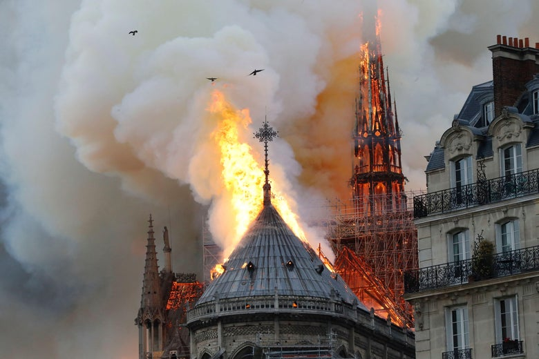 A close-up of flames on the roof of the cathedral.
