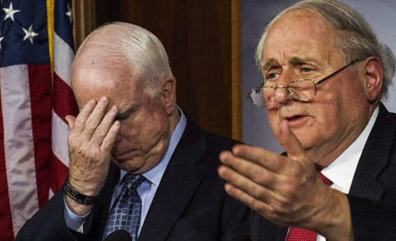 US Senators John McCain (L) and Carl Levin speak on proposed bipartisan changes to Senate.