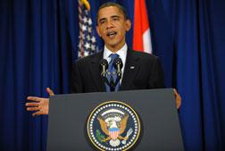 US President Barack Obama gestures during a press conference at the Bella Center in Copenhagen. Click image to expand.