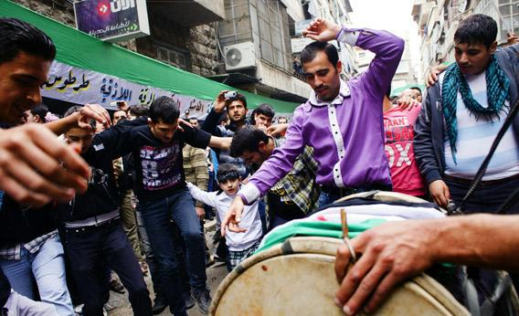 Syrian protesters dance during a demonstration against the regime.