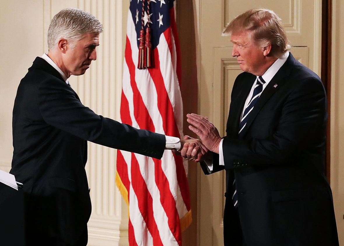 U.S. President Donald Trump shakes hands with Judge Neil Gorsuch after nominating him to the Supreme Court during a ceremony in the East Room of the White House January 31, 2017 in Washington, DC.