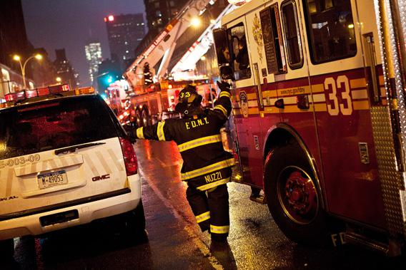 NEW YORK CITY—A firefighter speaks to a colleague while cleaning up damage caused by Hurricane Sandy Oct. 29, 2012