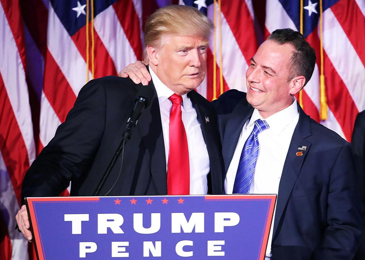 Republican president-elect Donald Trump and Reince Priebus, chairman of the Republican National Committee, embrace during his election night event at the New York Hilton Midtown in the early morning hours of November 9, 2016 in New York City.