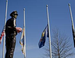 Flags at half-staff in memory of slain Pittsburgh police officers. Click image to expand.