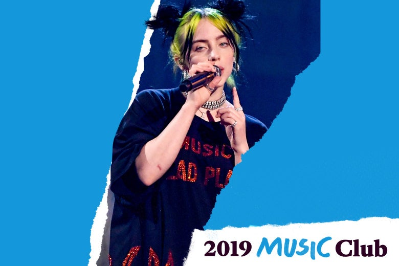 Billie Eilish performs in a shirt that says NO MUSIC ON A DEAD PLANET in sparkly letters. Text in the corner says 2019 Music Club.