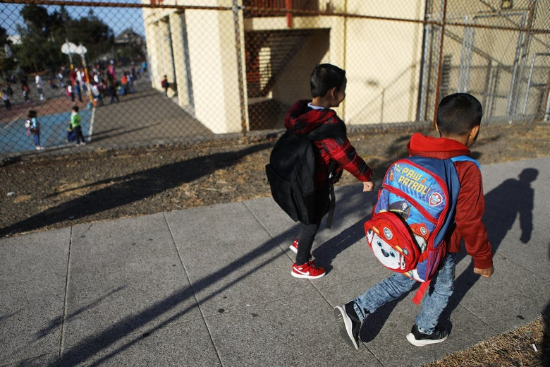 Honduran six-year-old Anthony walks to school on September 10, 2018 in Oakland, California. He and his father Juan fled their country, leaving many family members behind, and crossed the U.S. border in April at a lawful port of entry in Brownsville, Texas seeking asylum. They were soon separated and spent the next 85 days apart in detention.