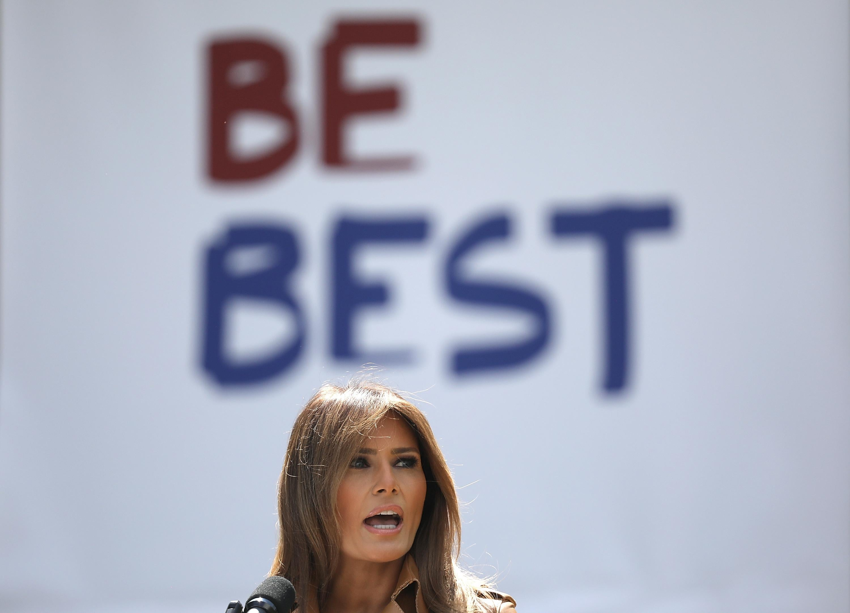 "A ""Be Best"" poster is seen behind Melania Trump's head."