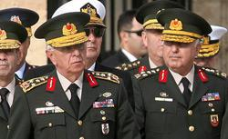 (Left) Gen. Isik Kosaner. Click image to expand.
