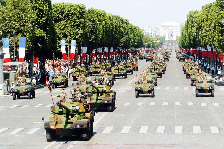 French armored vehicles roll down the Champs-Élysées in Paris during the the annual Bastille Day military parade on July 14, 2004.
