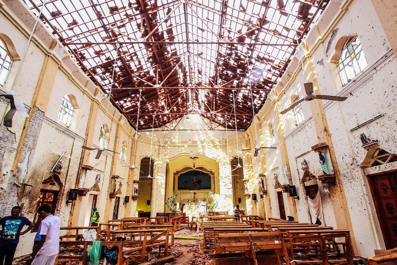 Sri Lankan officials inspect St. Sebastian's Church in Sri Lanka.