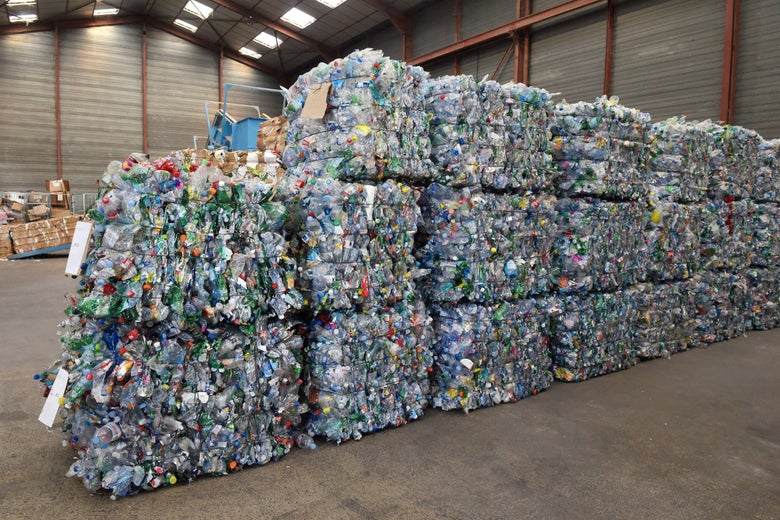 Piles of recyclable plastic bottles in a warehouse