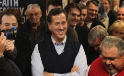 Republican presidential candidate former U.S. Senator Rick Santorum (R-PA) waits to be introduced during a campaign stop at the Daily Grind coffee shop on January 1, 2012 in Sioux City, Iowa.