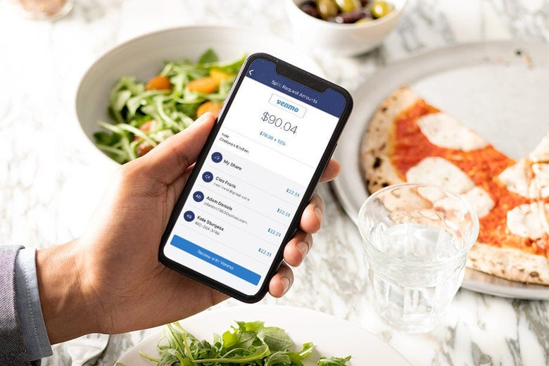The Venmo app on a smartphone above food.