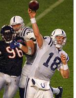 Quarterback Peyton Manning throws a pass. Click image to expand.