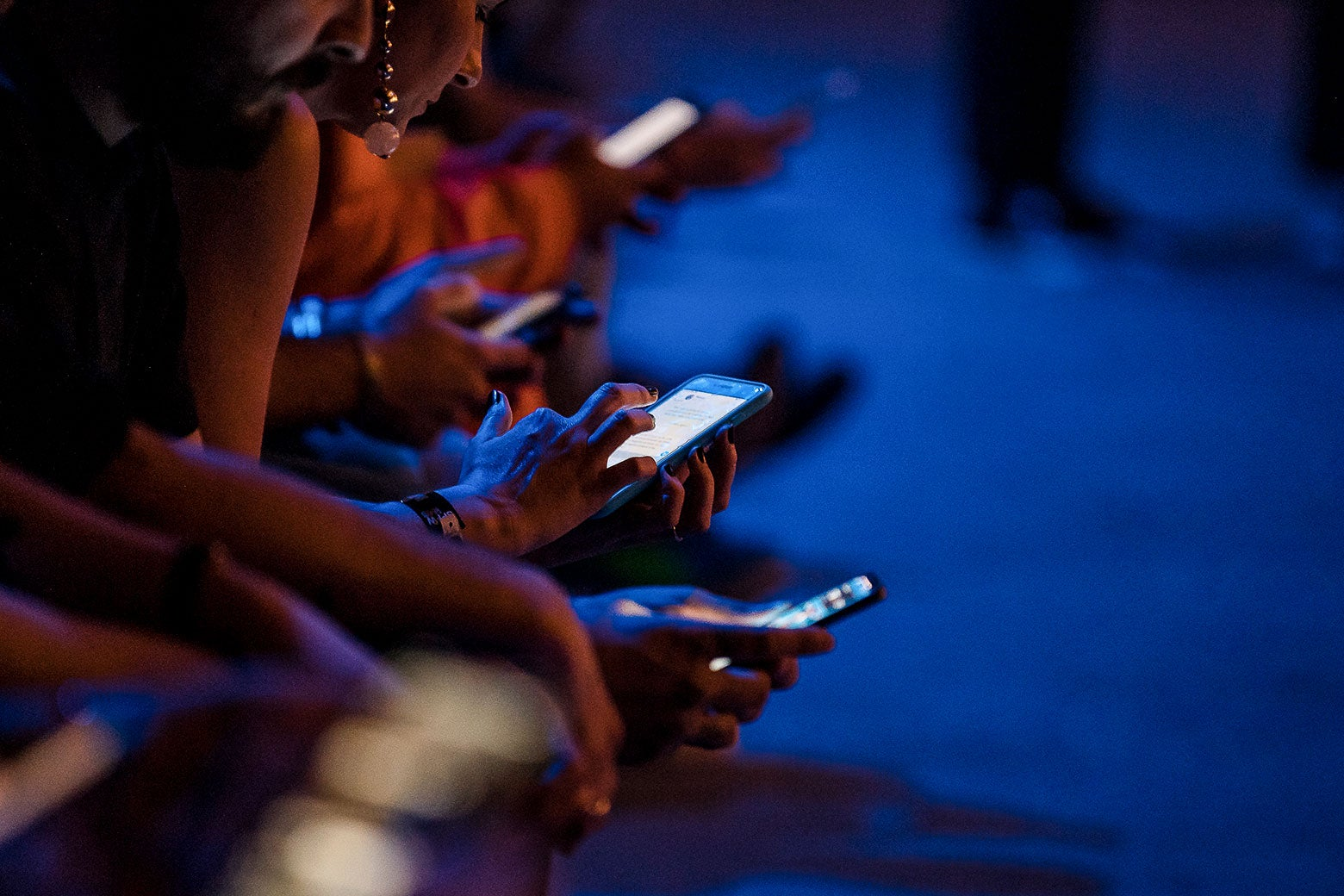 Audience members with cellphones out at Sao Paulo Fashion Week N46 SPFW Winter 2019
