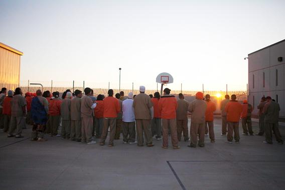 Inmates welcome the sun in celebration of the Makahiki season, the ancient Hawaiian New Year, at the Sahuaro Correctional Center in Eloy, Arizona November 9, 2011.
