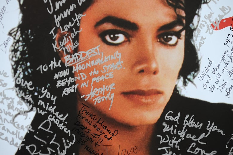A poster of Michael Jackson with scribbles on it.