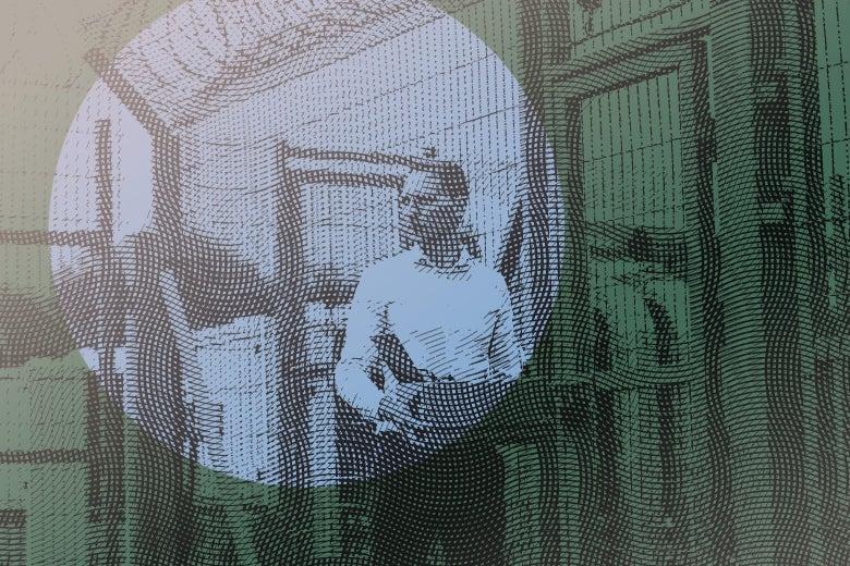 man leaving prison carrying a box