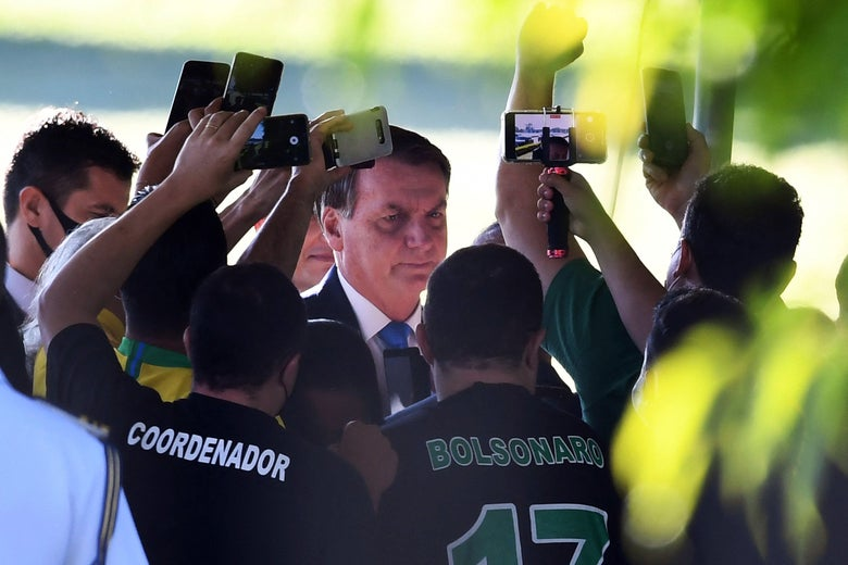 Bolsonaro thronged by people recording him on cellphones