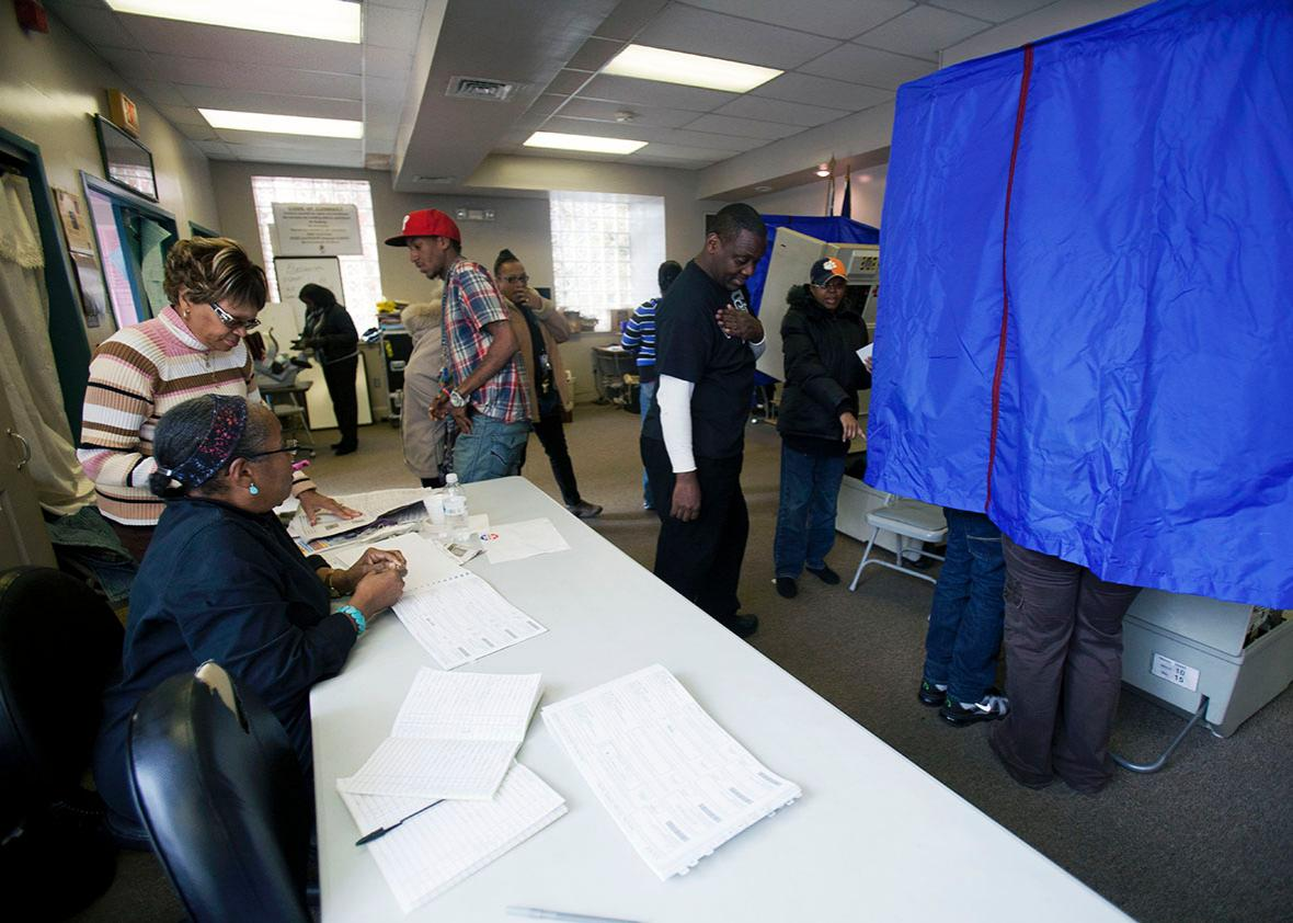 Residents cast their ballots at a polling place inside the Concerned Black Men's Office on November 6, 2012 in North Philadelphia, Pennsylvania.