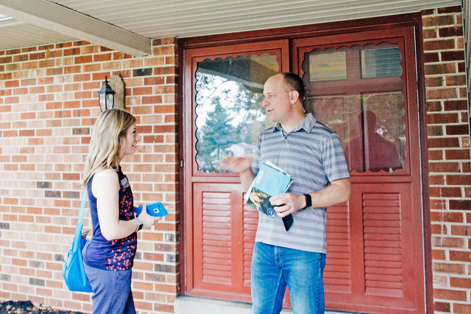 Pennsylvania state Senate candidate Katie Muth talks to Collegeville resident Nigel Piggott, who said he planned to support her.
