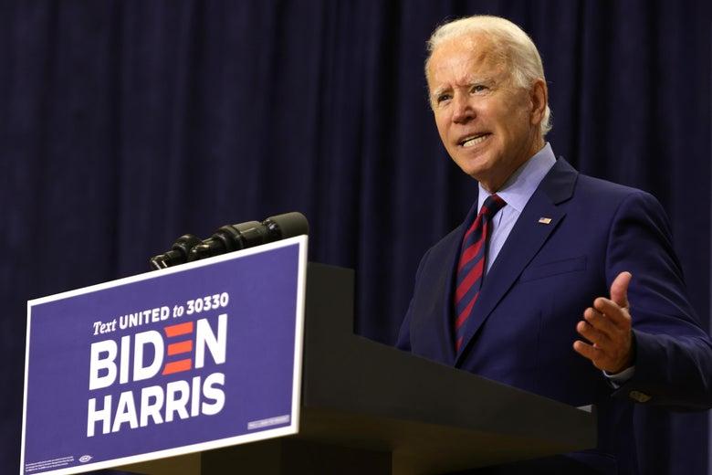 Biden speaks at a lectern carrying the Biden-Harris campaign logo.