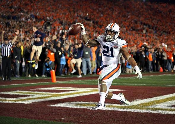 Auburn running back Tre Mason celebrates after scoring a fourth-quarter touchdown to take the lead in the BCS title game on Jan. 6, 2014.
