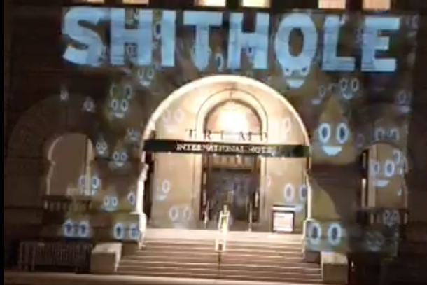 "A screen grab of video posted on Twitter showing the word ""SHITHOLE"" projected onto the Trump International Hotel in Washington, D.C. on January 14, 2017."