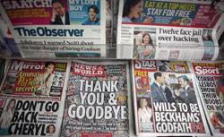 Copies of the last-ever News of The World newspaper are for sale at a newsagents in central Manchester. Click image to expand.