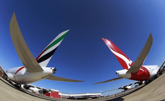 Emirates and Qantas A380 aircraft sit on the tarmac at Kingsford Smith international airport in Sydney September 6, 2012.