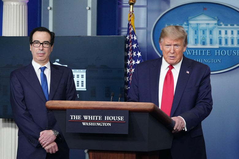 Mnuchin folding his arms and looking obsequious as Trump stands at the podium.