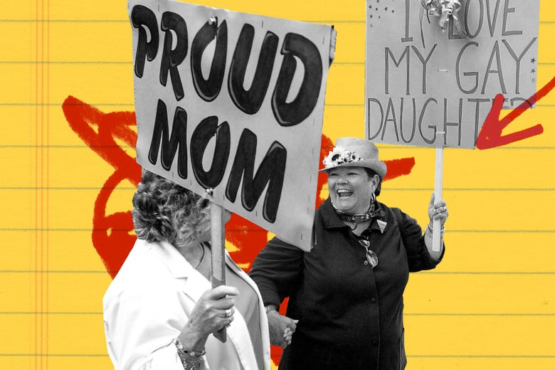 """Two women holding up signs that say """"Proud Mom"""" and """"I love my gay daughter."""""""