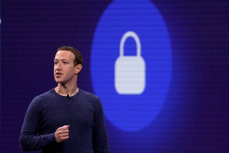 Mark Zuckerberg in front of a slide featuring a padlock icon.