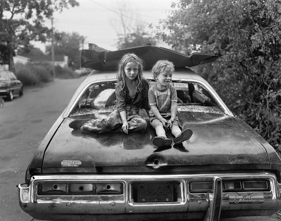 Children on Wrecked Car