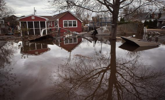 "Flooding in Staten Island in the aftermath of Sandy. It would be more cost efficient to build seawalls and ""storm doors"" for subways than to fight carbon emissions"