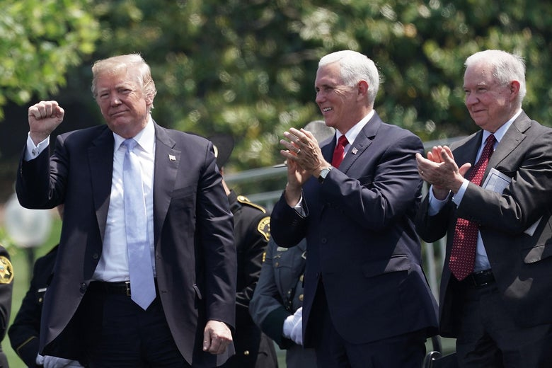 President Donald Trump, Vice President Mike Pence, and Attorney General Jeff Sessions cheer.