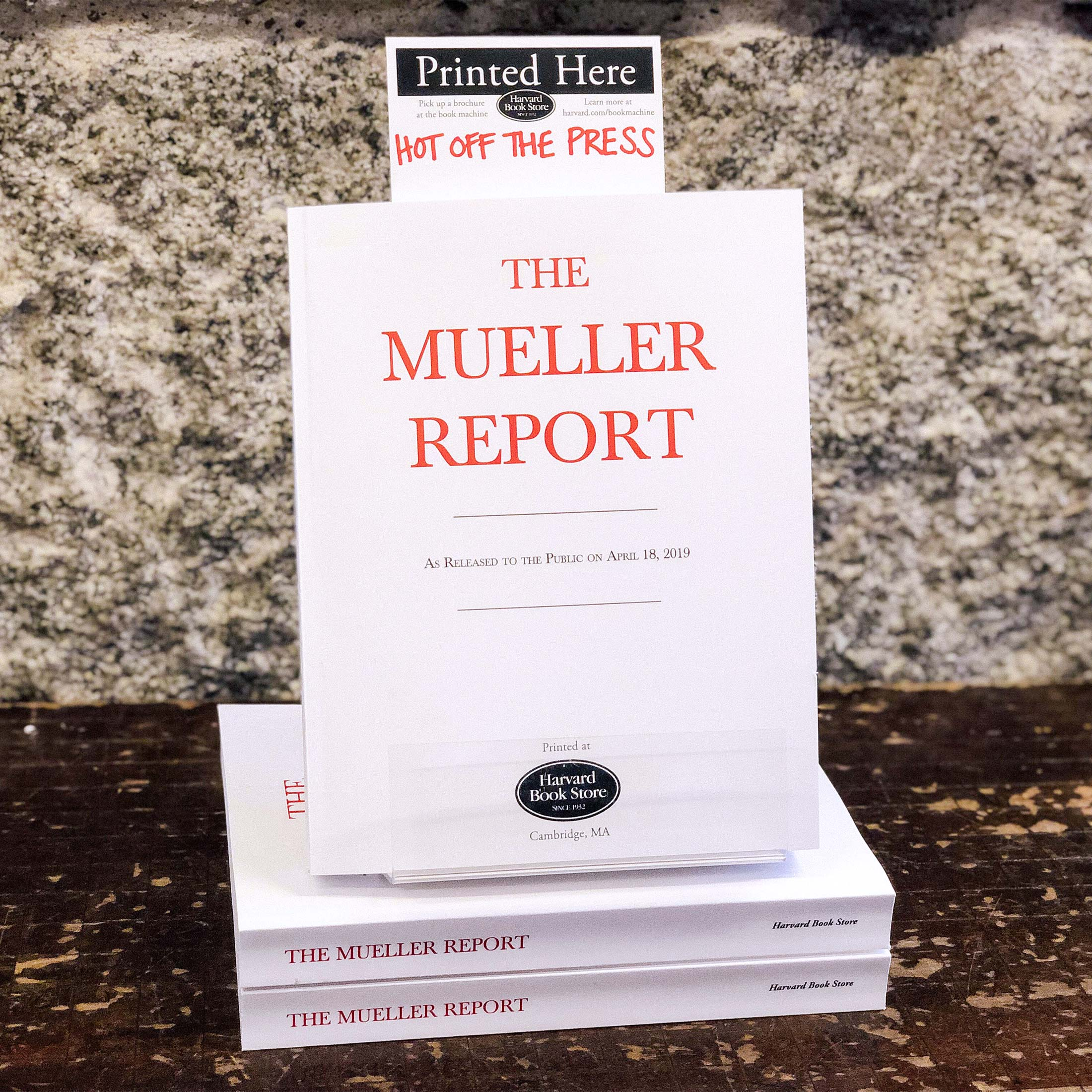 Display of bound copies of the Mueller report at the Harvard Book Store.