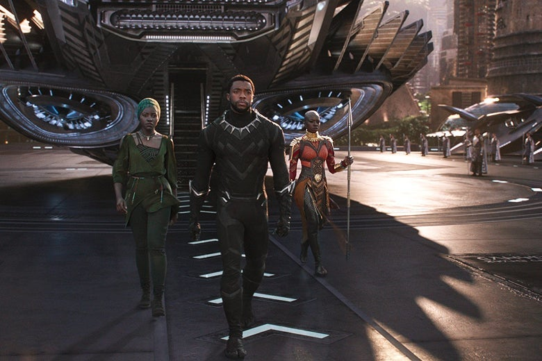 Three characters from Black Panther walk out of a space ship.