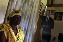 Sarah Onyango Obama in her living room in Kogelo, as her grandson's likeness stands in the corner. Click image to expand.
