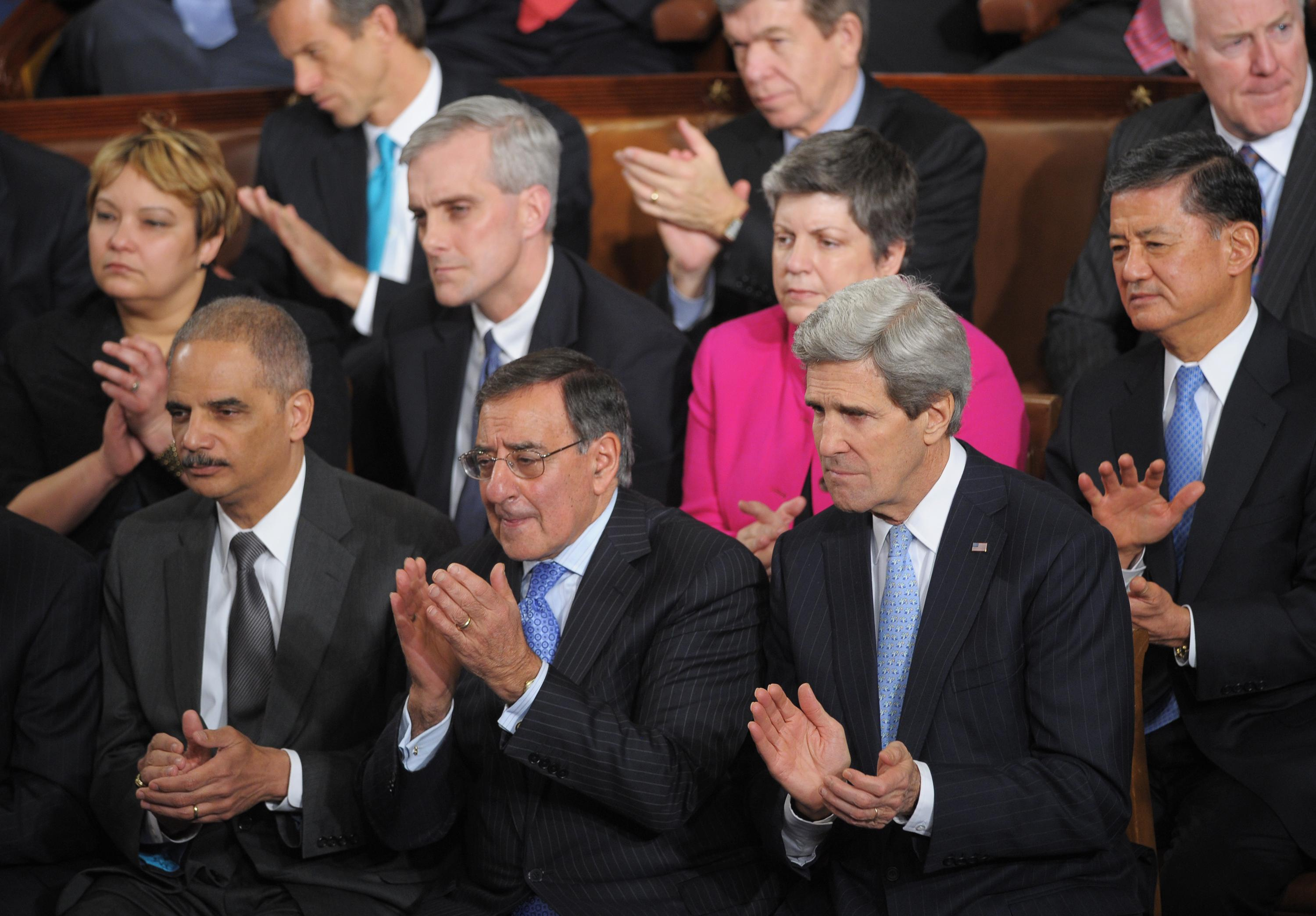 (Front row) Attorney General Eric Holder, outgoing Defense Secretary Leon Panetta, Secretary of State John Kerry, EPA Administrator Lisa Jackson, White House Chief of Staff Denis McDonough, Homeland Security Secretary Janet Napolitano and Veterans Affairs Secretary Eric Shinseki applaud as President Barack Obama delivers his State of the Union address before a joint session of Congress on February 12, 2013, at the U.S. Capitol in Washington, D.C.