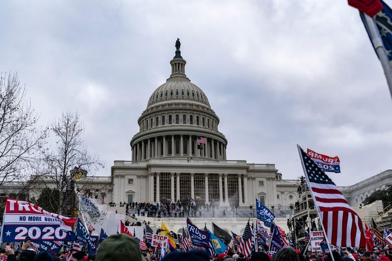 Supporters of US President Donald Trump protest outside the US Capitol on January 6, 2021, in Washington, DC. - Demonstrators breeched security and entered the Capitol as Congress debated the a 2020 presidential election Electoral Vote Certification. (Photo by ALEX EDELMAN / AFP) (Photo by ALEX EDELMAN/AFP via Getty Images)