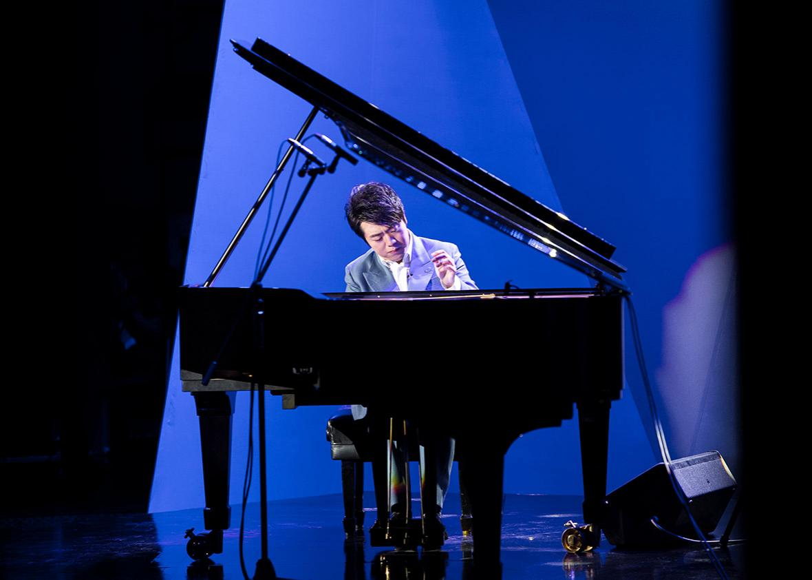 Pianist Lang Lang performs during a concert.