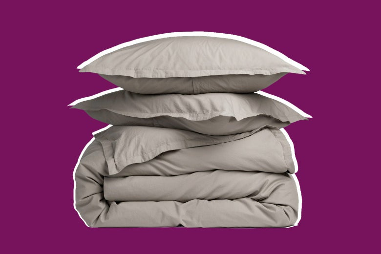 Folded duvet with two pillows stacked on top