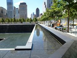 At New York's Sept. 11 Memorial, water-filled pits stand where the towers once were.