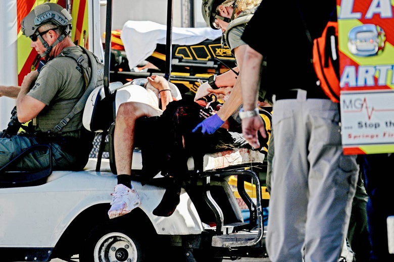 Medical personnel tend to a victim following a shooting at Marjory Stoneman Douglas High School in Parkland, Florida, on Wednesday.