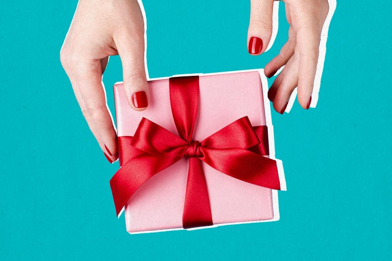 Two hands with red nail polish hold a wrapped gift box