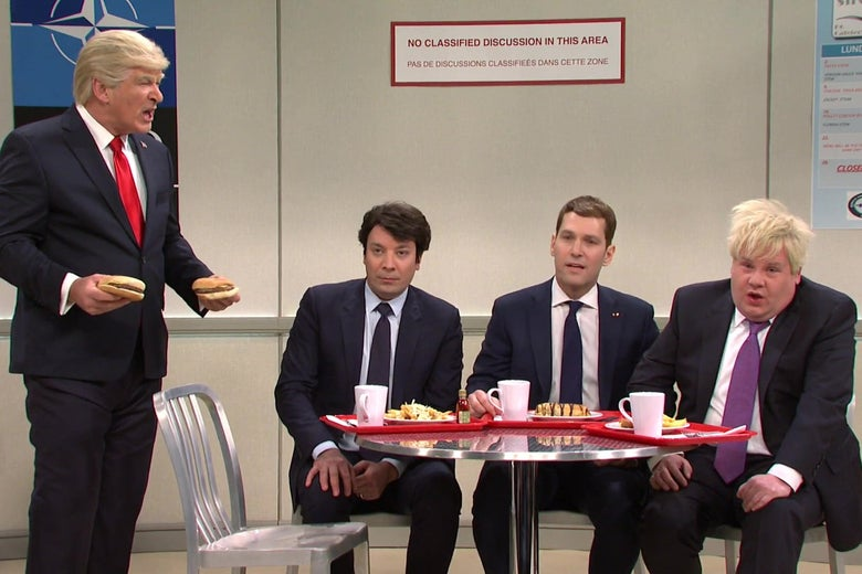Alec Baldwin, as Donald Trump, stands in a cafeteria, yelling at a table where Jimmy Fallon as Justin Trudeau, Paul Rudd as Emmanuel Macron, and James Corden as Boris Johnson are sitting, looking chastened.