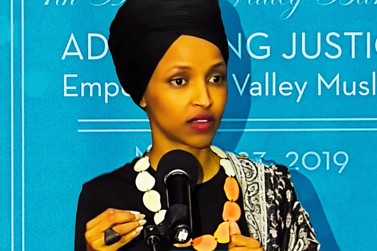 Ilhan Omar at a microphone.