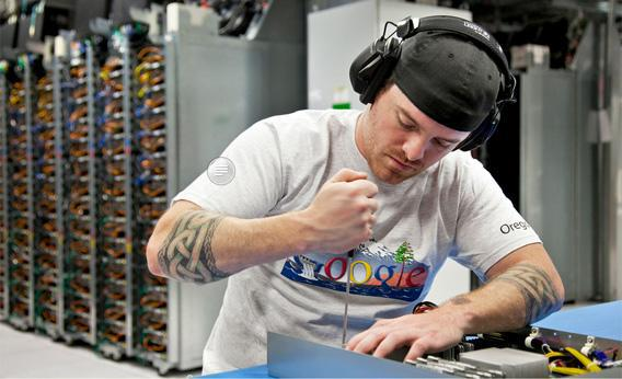 Google Employee Mike Barham swaps out a motherboard at the company's Dalles data center in Oregon.