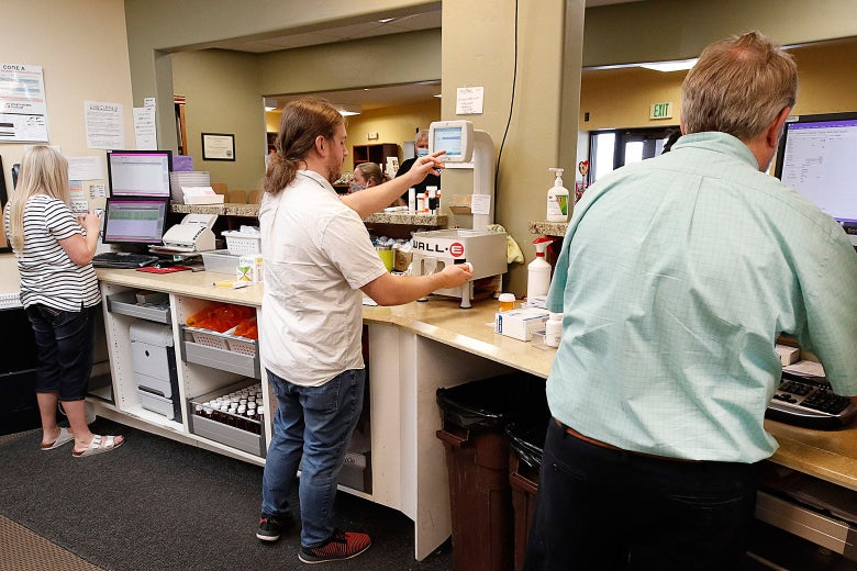 Pharmacists and pharmacy techs fill prescriptions in Provo, Utah.